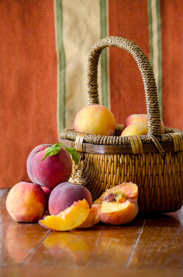 Peaches in a basket royalty free stock photos