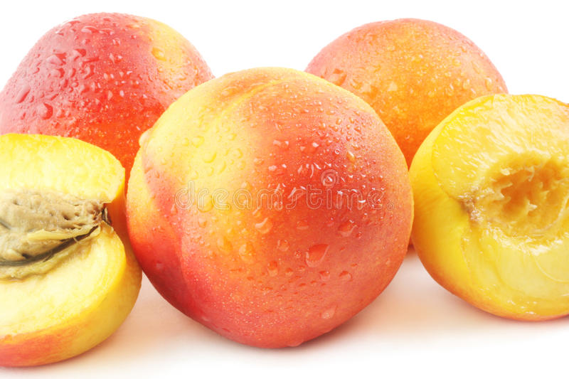 Peaches fresh group. On white background. Whole and half of peach with drops of water stock images