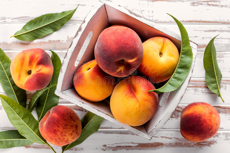 Peaches. Fresh ripe peaches on a wooden tablen royalty free stock images