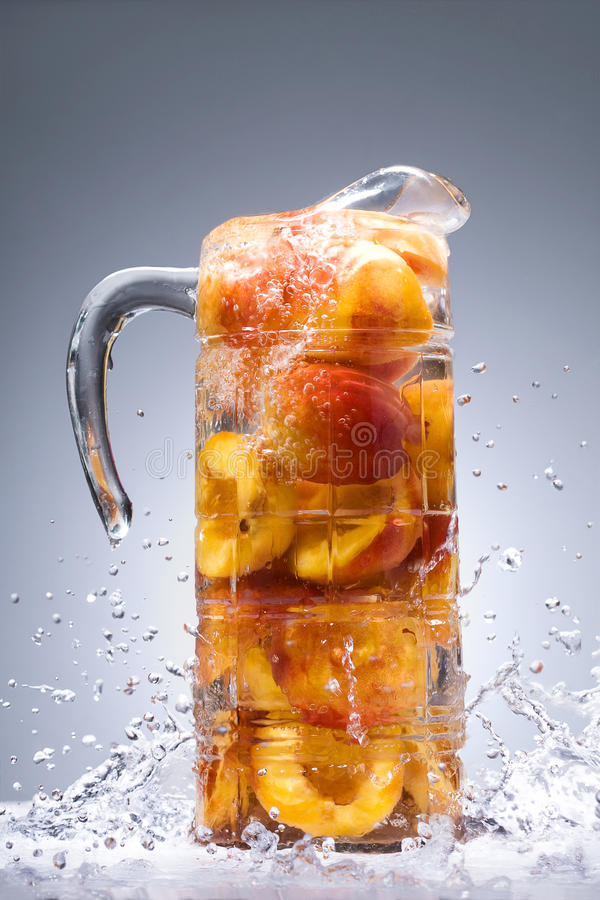 Download Peaches With Juice In A Jug Stock Image - Image: 20758199