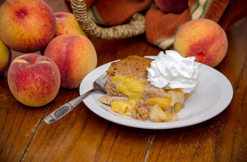 Peaches and a Peach cobbler dessert stock images