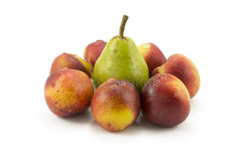 Peaches and pears on a white background stock images