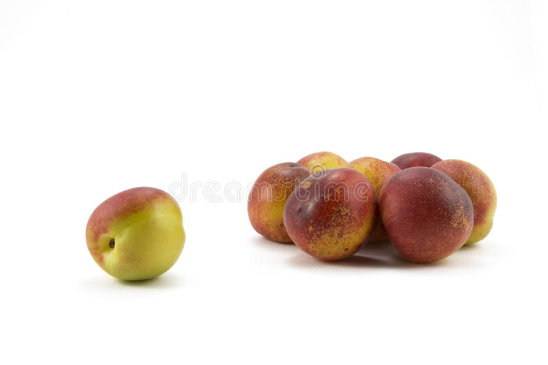 Peaches and pears on a white background royalty free stock photo