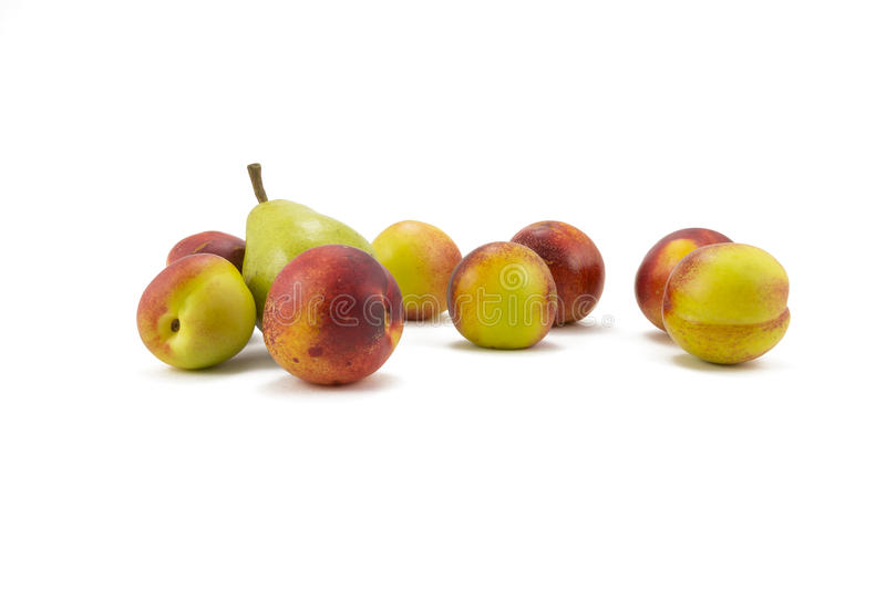 Peaches and pears on a white background royalty free stock image