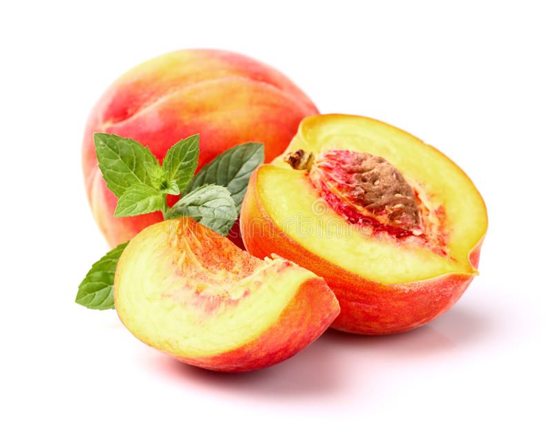 Peaches with peppermint stock images
