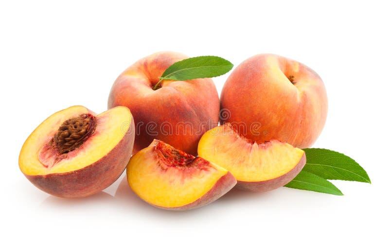 Peaches. Ripe peaches on white background royalty free stock image
