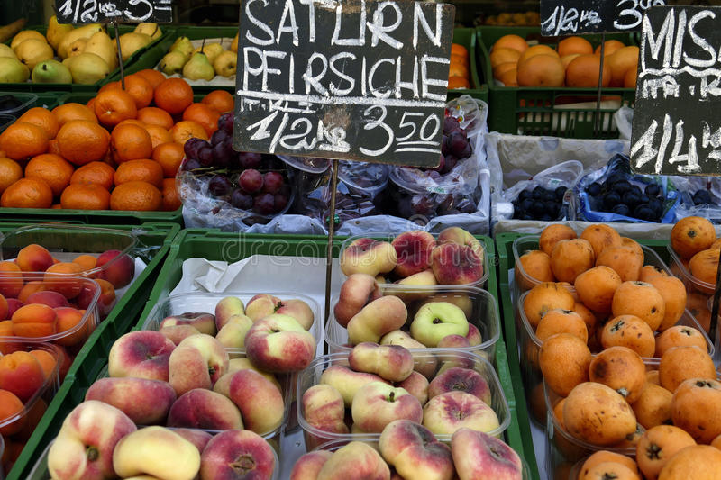 Peaches. Saturn on sale in street market in Prague, Czech republic royalty free stock images