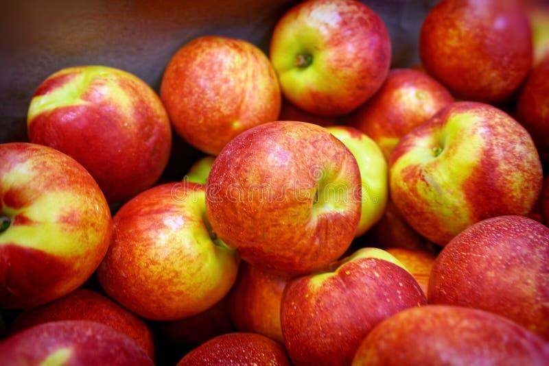 Peaches on the store shelves stock photos