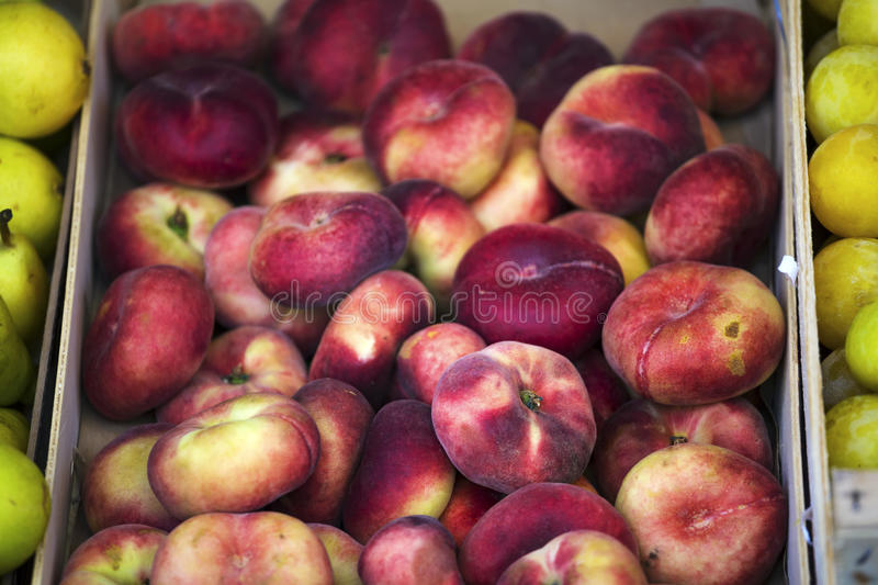 Peaches in a vegetable shop stock images