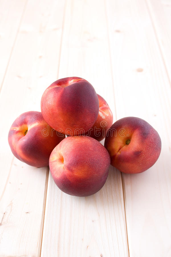 Peaches on wood table