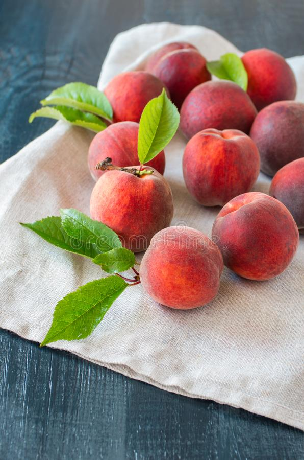 Ripe peaches on a wooden background. stock photography