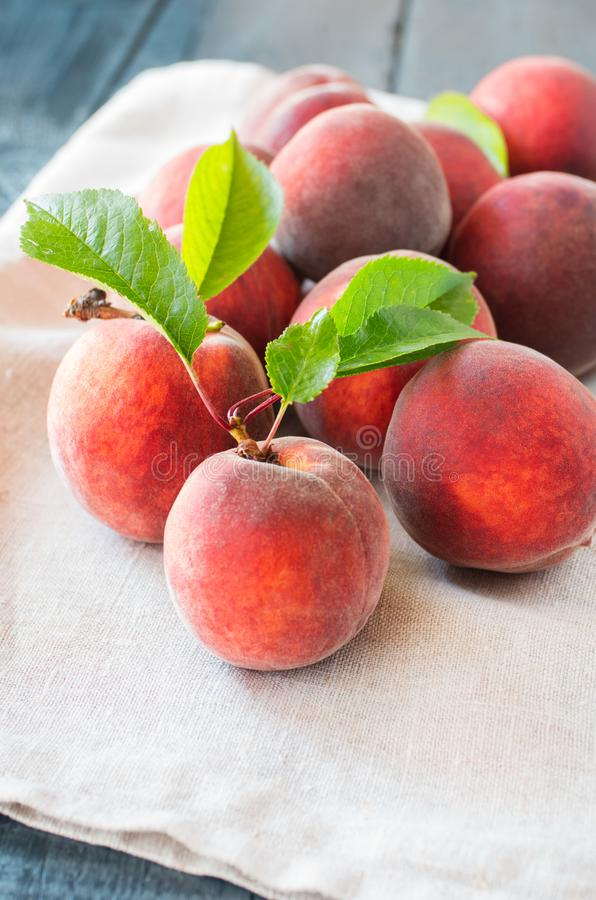 Ripe peaches on a wooden background. royalty free stock photography