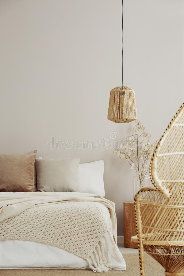 Free Peacock Chair, Wicker Chandelier And Cozy Bed, Copy Space On Empty Wall Stock Photography - 153446692