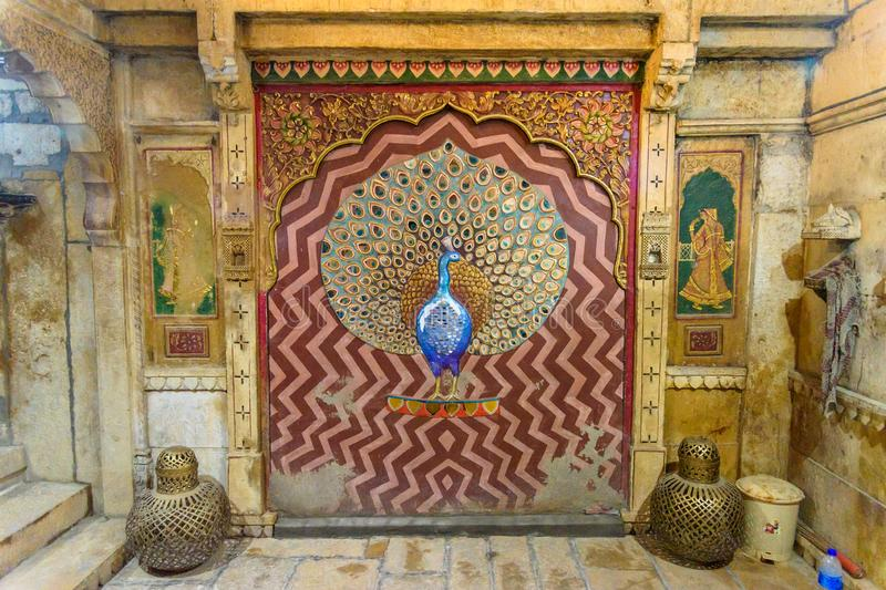 Peacock made of molten glass and mirrors on wall of Patwon ki Haveli palace in Jaisalmer. india. Jaisalmer, India - February 13, 2019: Peacock made of molten royalty free stock image