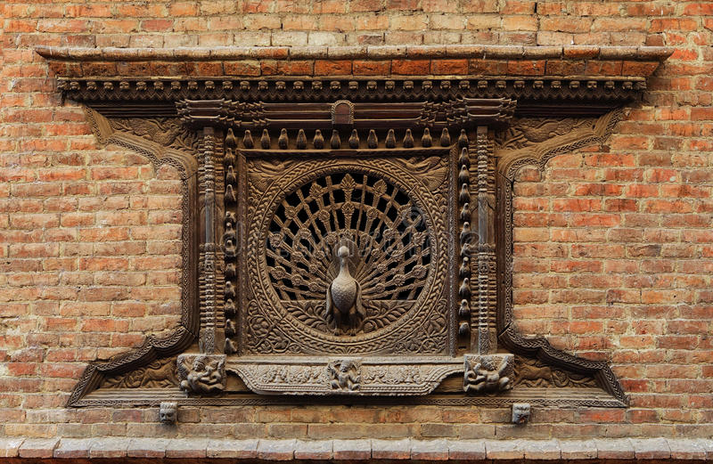 Peacock window. Bhaktapur, Kathmandu valley, Nepal. royalty free stock photography