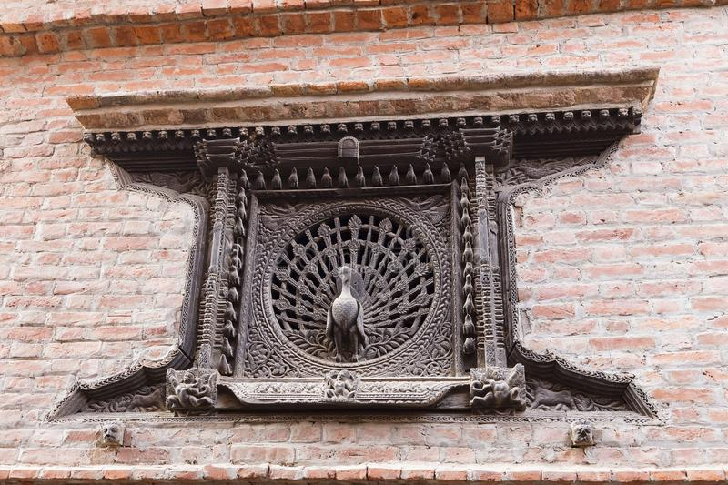 The Peacock Window, an early 15th century latticed window, Bhaktapur, Nepal royalty free stock image