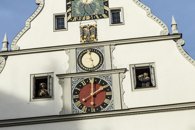 Peak Of A Building With A Clock Against A Blue Sky in Rothenburg Germany. Peak Of A Building With A Clock Against A Blue Sky in Rothenburg ob der Tauber, Germany royalty free stock image