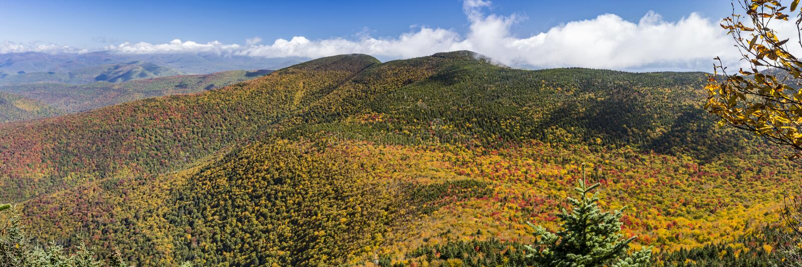 Peak Color Panorama from Slide Mountain. Cornell and Wittenburg Mountains shrouded in misty clouds, seen from a lookout on Slide Mountain during peak Autumn royalty free stock photography