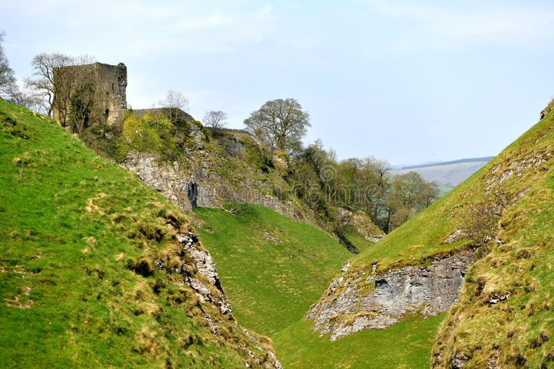 Peak District UK, old historic Peveril Castle, climb. A climb to the castle at the top of the hill to enjoy the breathtaking views over the Hope Valley is a stock images