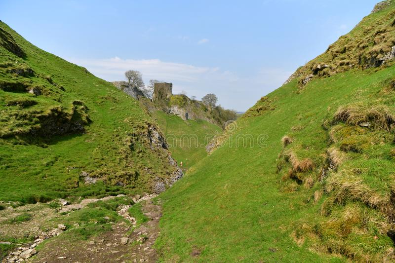 Peak District UK, old historic Peveril Castle, climb. A climb to the castle at the top of the hill to enjoy the breathtaking views over the Hope Valley is a stock photos