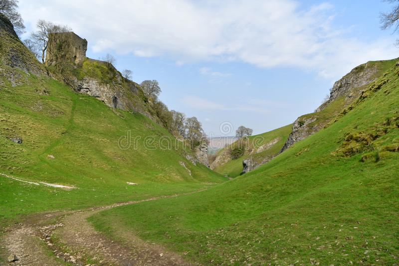 Peak District UK, old historic Peveril Castle, climb stock photography