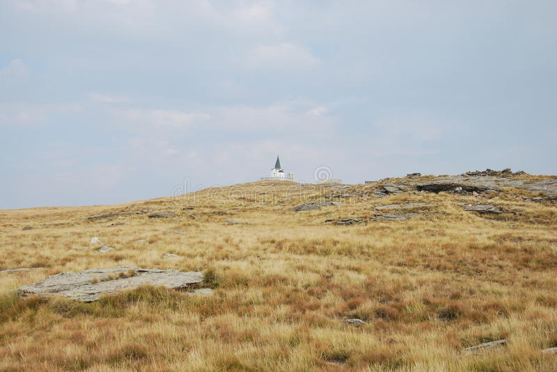 The peak of Kajmakchalan, place of a WWI battle. View towards the top of Kajmakchalan. On the top a small church (called Prophet Ilia church) was built to royalty free stock photography