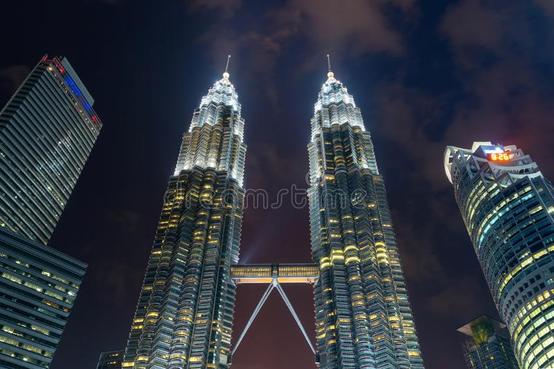 The peak of Petronas Twin Towers. Kuala Lumpur Downtown, Malaysia. Financial district and business centers in smart urban city in royalty free stock photography