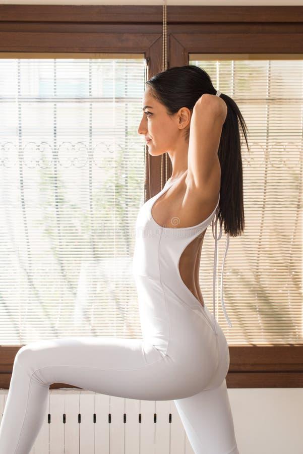 Peak Pilates - Pilates Trainer Exercising on Peak Pilates Reformer royalty free stock photo