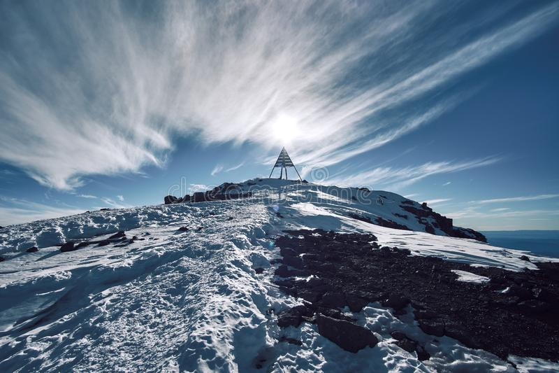 Peak pyramid of Jebel Toubkal with unusual hairy clouds formations royalty free stock photography