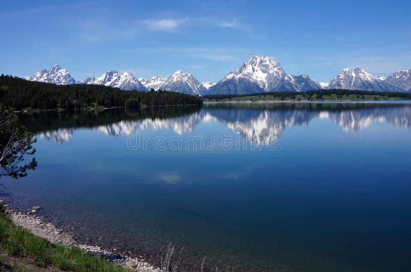 Peak Reflections. Reflections of the Grand Tetons in Jackson Lake, WY stock image