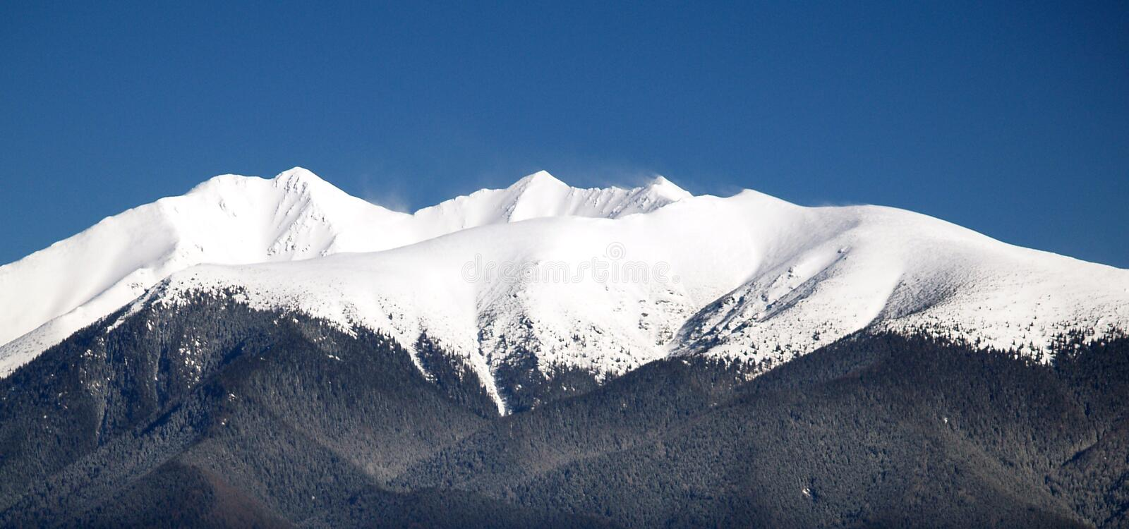 Peak of Rohace mountain. Peak of mountain named Rohace covered with snow, in Slovakia stock photography