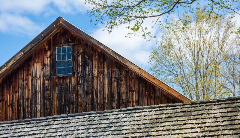 Peak of Williams Barn over roof of smaller adjacent barn royalty free stock photo
