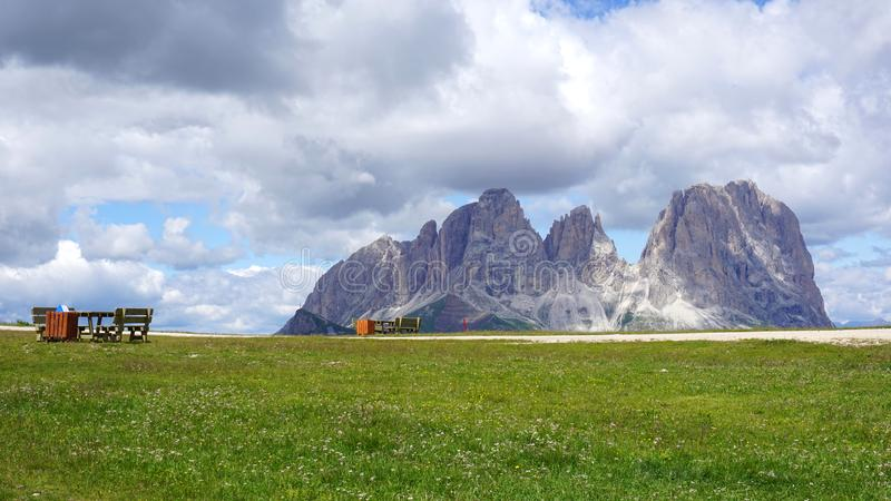 Peaks of Dolomites in summer with resting places for hikers royalty free stock photos