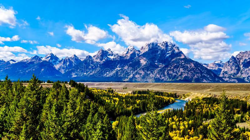 The peaks of The Grand Tetons behind the winding Snake River viewed from the Snake River Overlook. On Highway 191 in Grand Tetons National Park, Wyoming, United royalty free stock photos