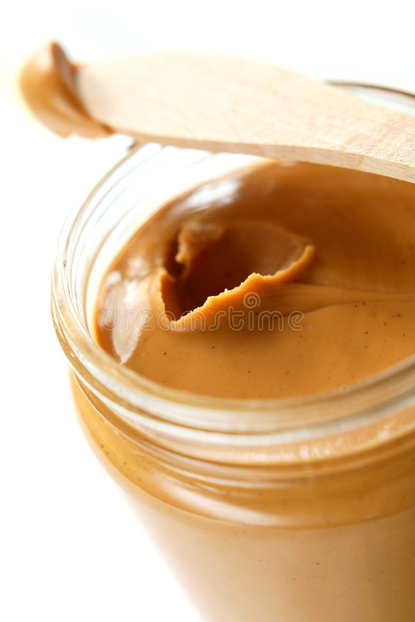 Peanut Butter. Open the peanuts butter jar. Peanut butter is excellent addition for sandwiches and desserts stock photo