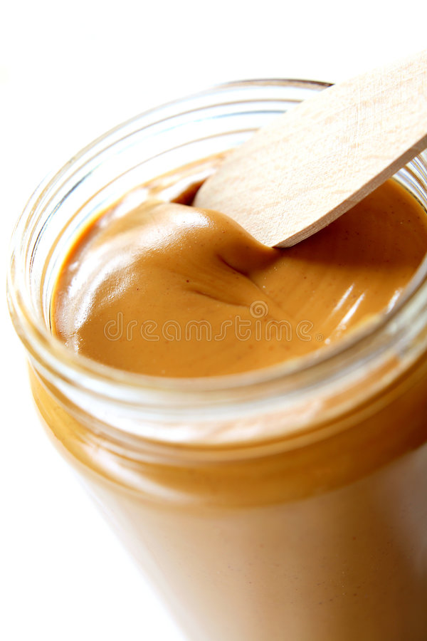 Peanut Butter. Open the peanuts butter jar. Peanut butter is excellent addition for sandwiches and desserts royalty free stock photography