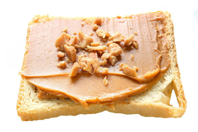 Peanut Butter. Slice of bread with peanut butter and nuts. Peanut butter is excellent addition for sandwiches and desserts stock photo