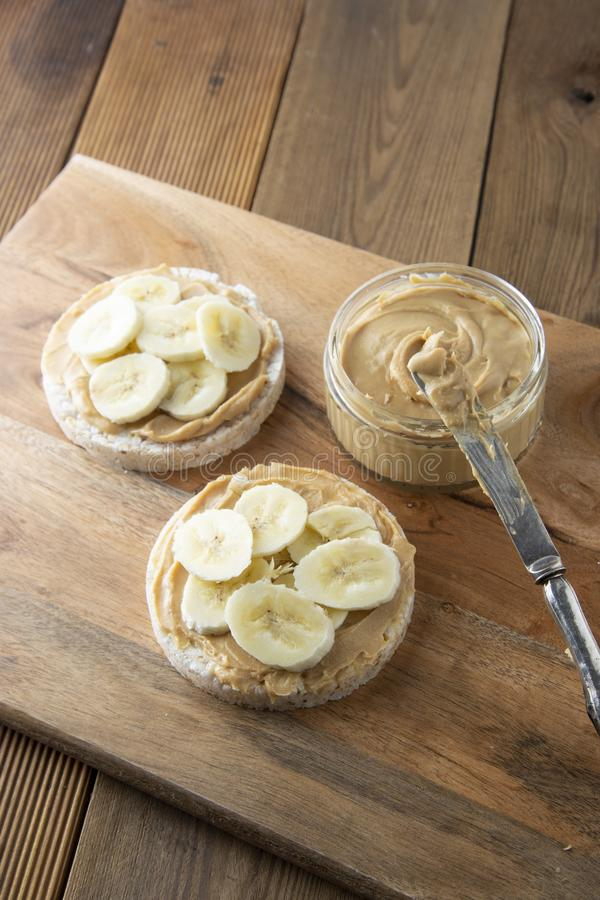 Peanut butter and banana on rice cakes, healthy breakfast, dietary food for children or work lunch stock photo