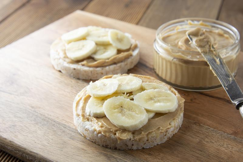 Peanut butter and banana on rice cakes, healthy, dietary food stock images