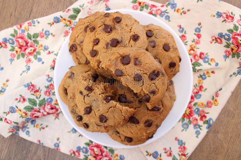 Peanut butter chocolate chip cookies on a white plate. Delicious homemade peanut butter chocolate chip cookies royalty free stock photography