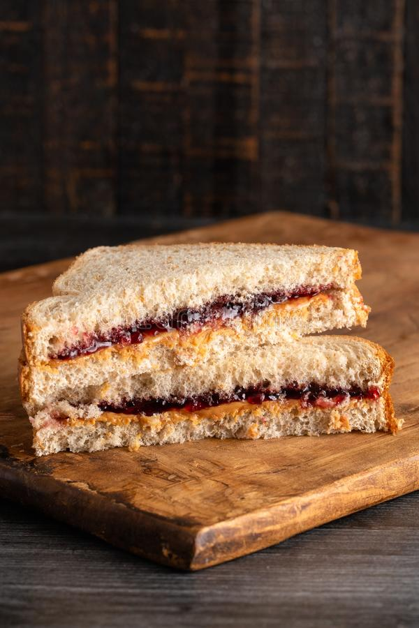 Peanut Butter and Grape Jelly Sandwich on a Wooden Cutting Board royalty free stock photography