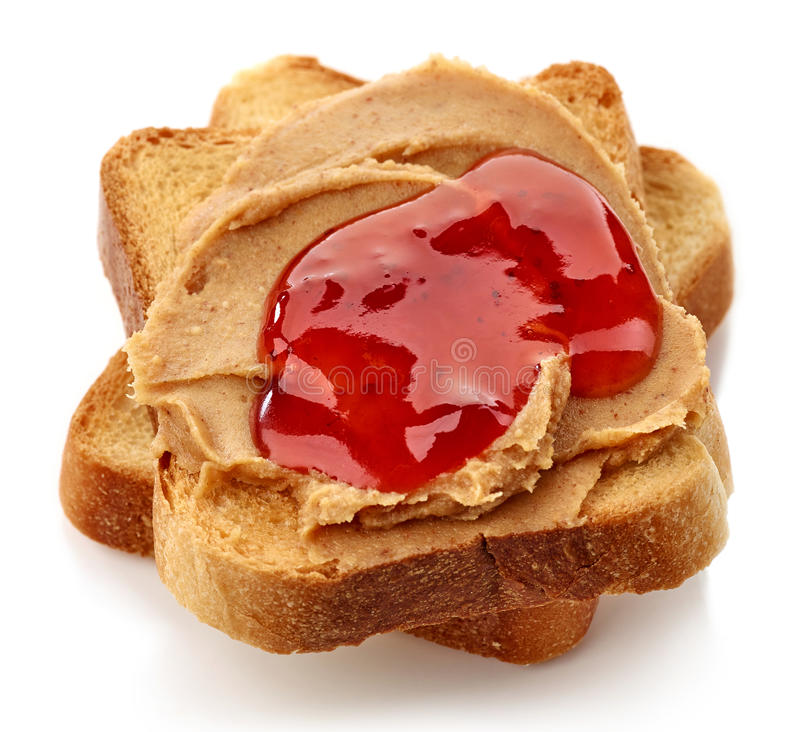 Peanut butter jelly sandwich. Peanut butter and strawberry jelly sandwich isolated on white background stock photo