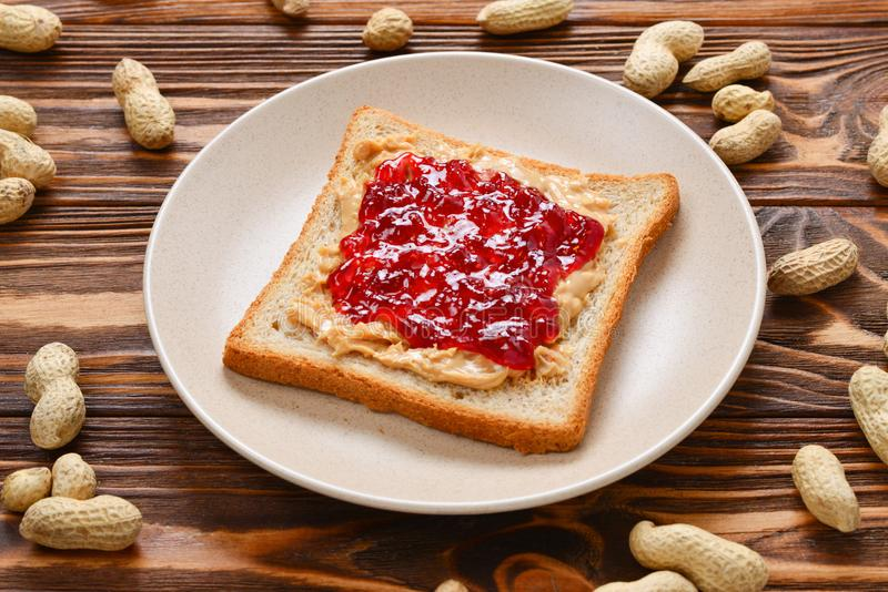 Peanut butter and jelly sandwich on wooden background. stock photos