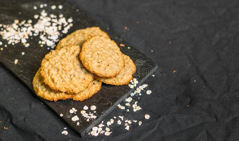 Peanut butter oatmeal cookies against black background. Peanut butter oatmeal cookies against background stock images