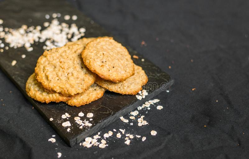 Peanut butter oatmeal cookies against black background. Peanut butter oatmeal cookies against background stock photography