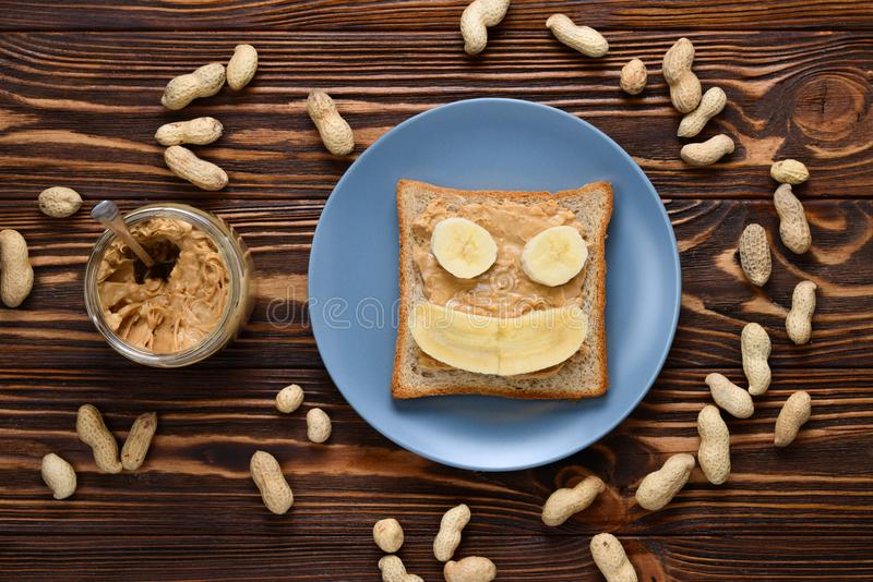 Peanut butter toast with banana slices royalty free stock photos