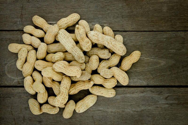 Peanut or groundnut, conceptual food allergy & health. Close up of peanut or groundnut on wooden background for food allergy health concept royalty free stock photos