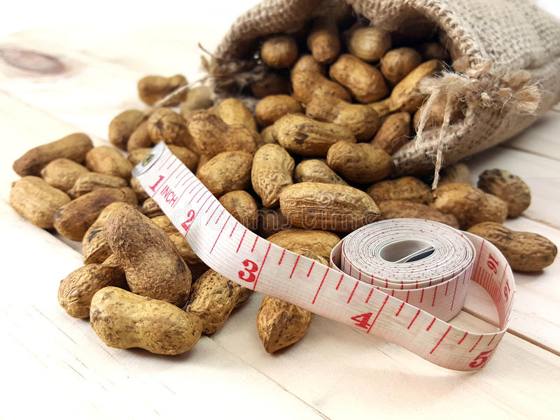 Peanut or groundnut with measuring tape. royalty free stock photo