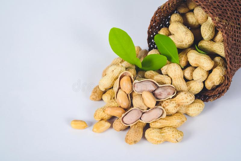 Peanut spill out of basket stock images