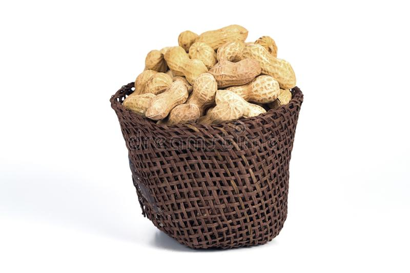 Peanut spill out of basket on white stock images